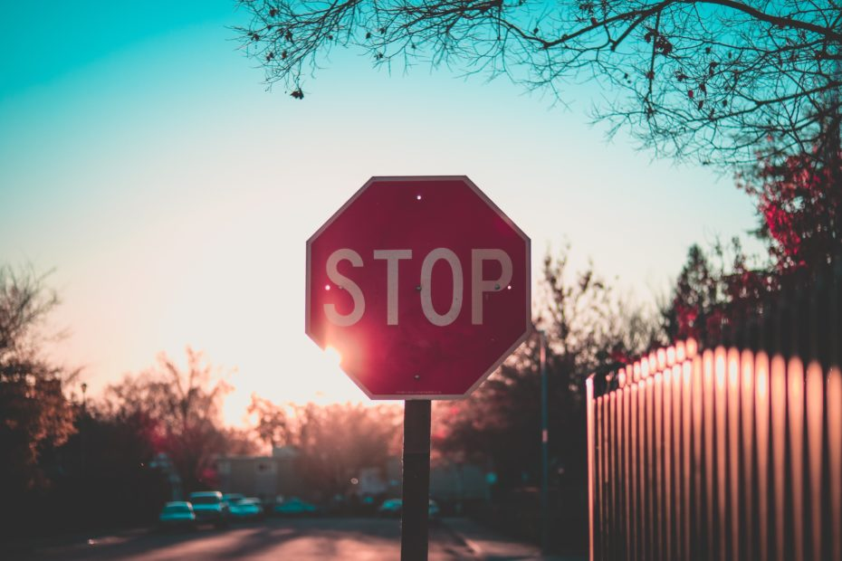stop sign in sunset